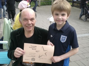 1st Prize winner Nicholas with FromeFM Station Manager Phil Moakes at the FromeFM fun day