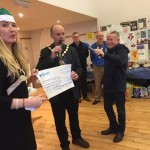 Frome Mayor Cllr. Rich Ackroyd presents Lucia Chadwick with a cheque for £500, part of Frome Town Council's total grants this year to AIT of £9000